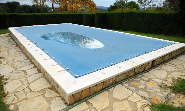 56704171 - pool with a tarp for protection in winter