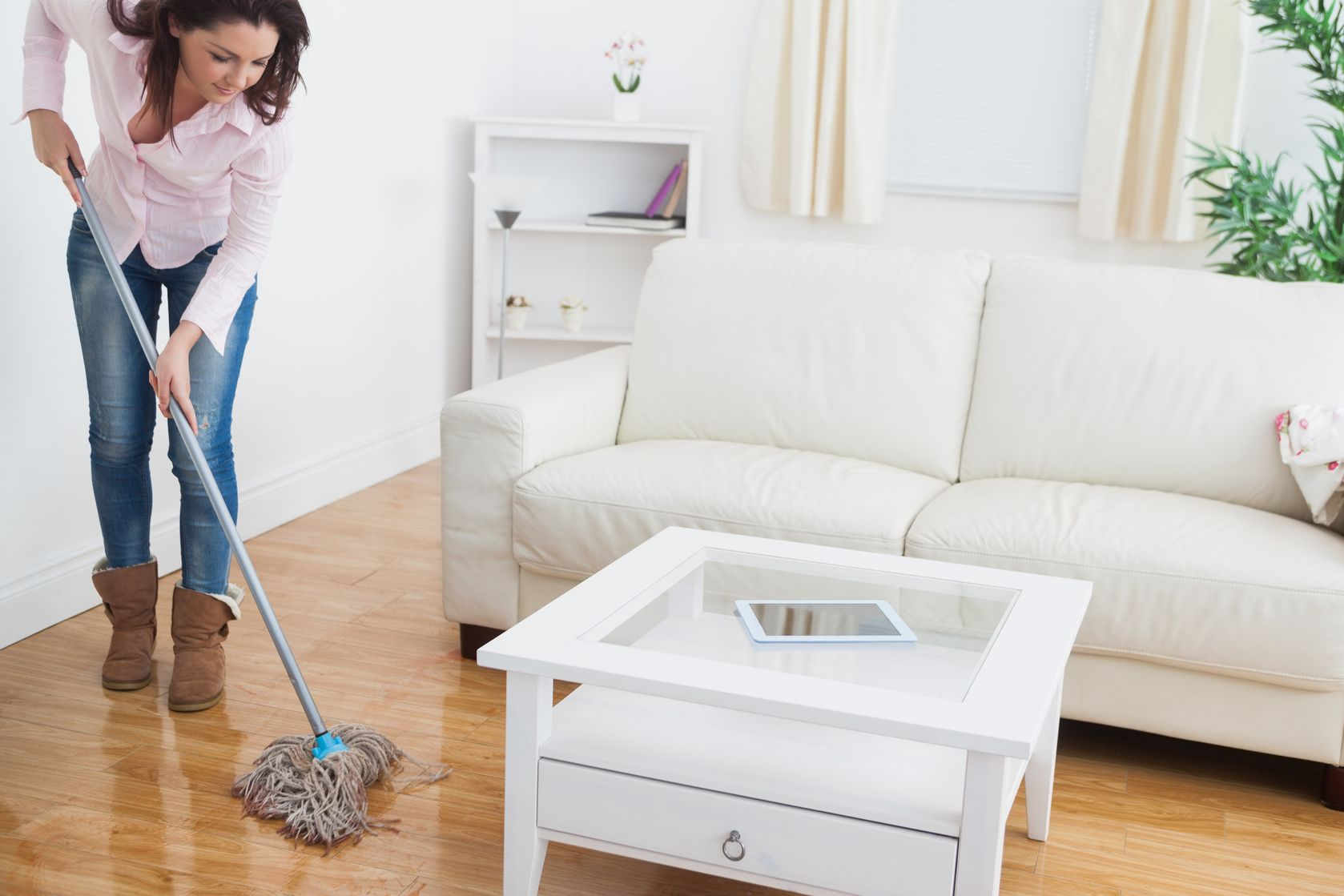 18123799 - young woman  mopping living room floor
