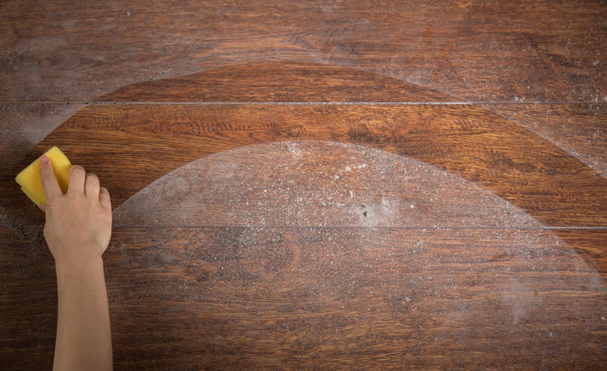 37416732 - photo of woman's hand cleaning the wooden floor